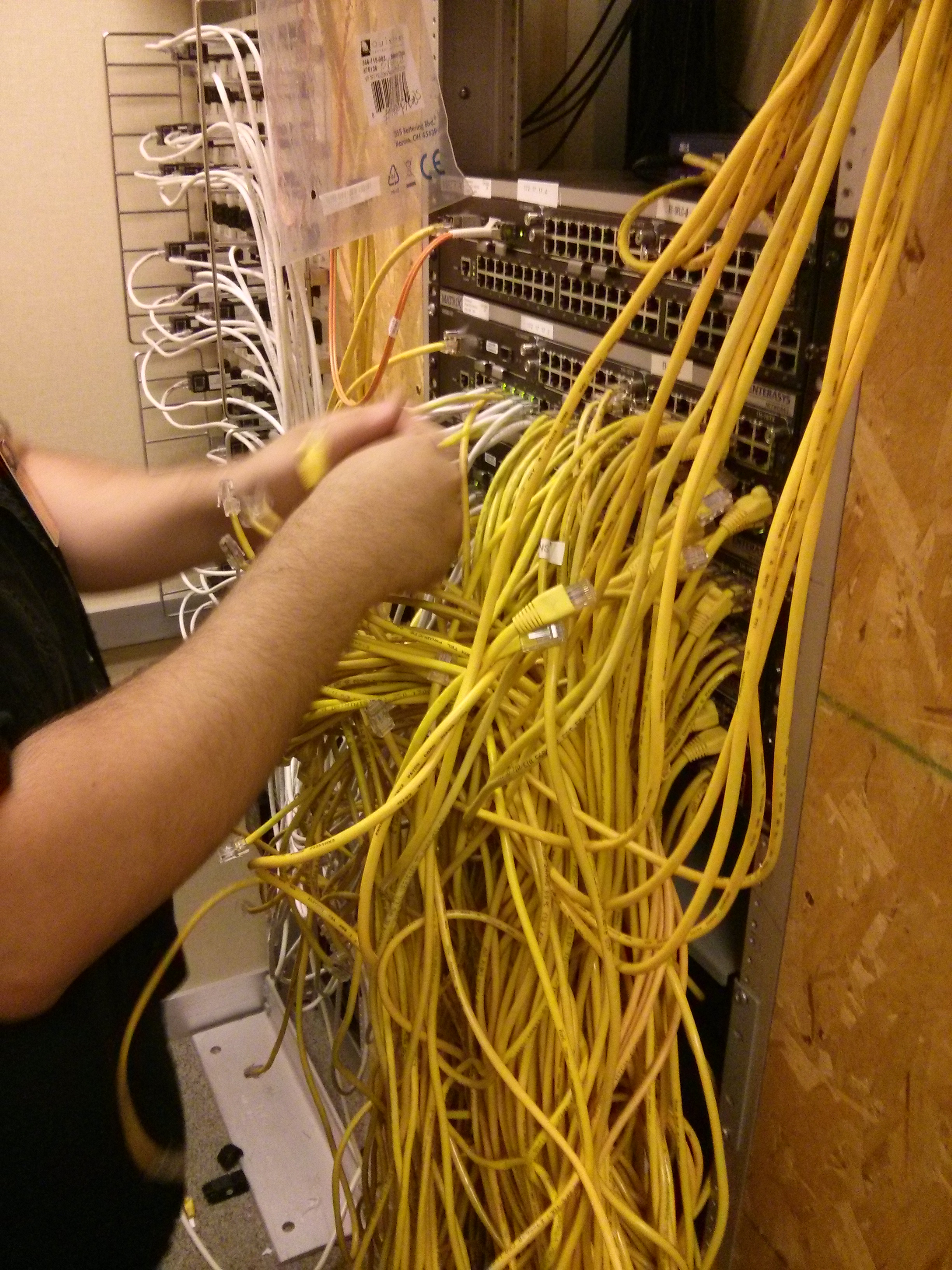 Network Administrator working in networking closet